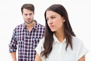 Upset man and woman avoiding eye contact