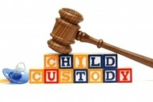 A gavel and bricks with CHILD CUSTODY words