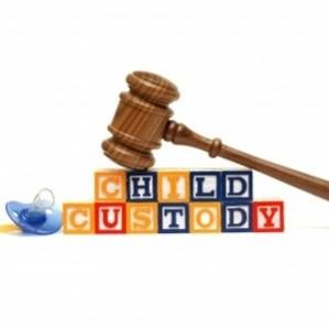 A gavel and bricks with CHILD CUSTODY words