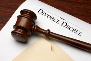 A gavel and a paper with DIVORCE DECREE words