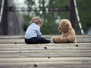 A sad child with his toy, children custody
