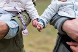 Parents holding babies, child custody lawyer