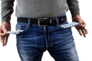 Man holding empty jean pockets