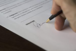 hand signing on an agreement, divorce lawyers