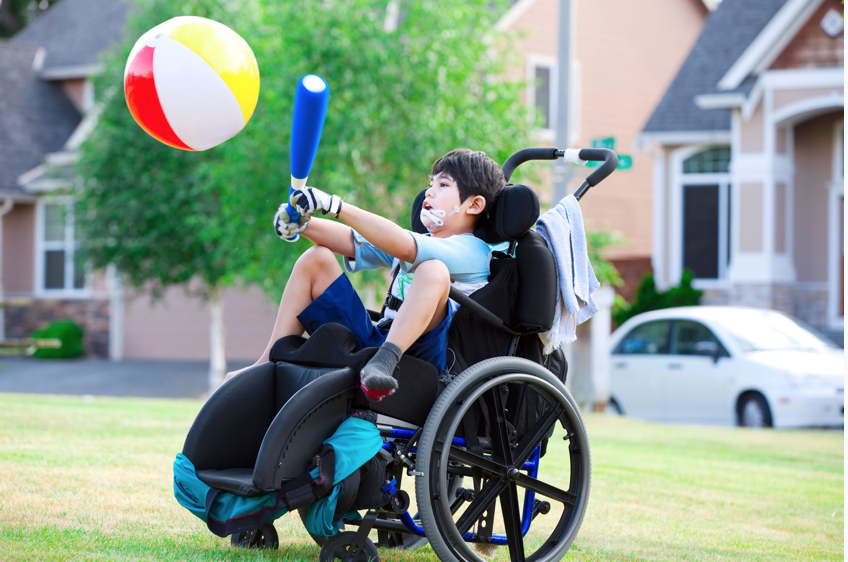 A child in a wheelchair playing