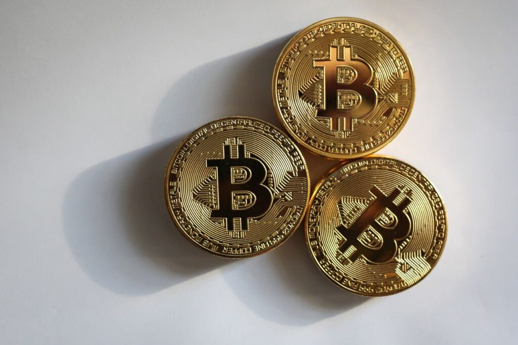 Three digital money coins, Cryptocurrency